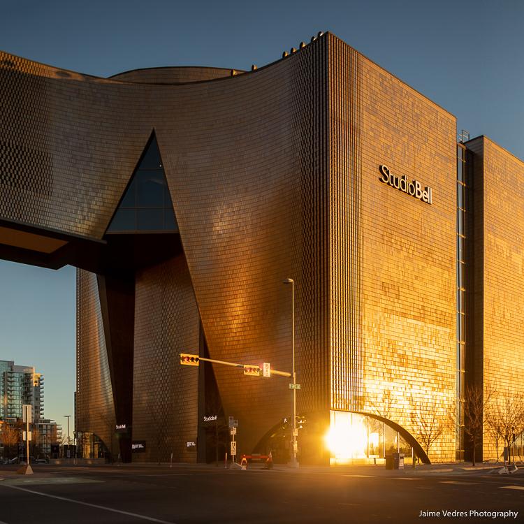 Warm sunrise colours on Calgary's Studio Bell building.